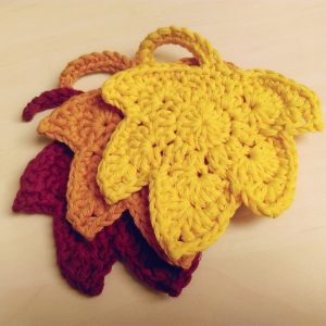 A pile of crochet autumn leaves coaster
