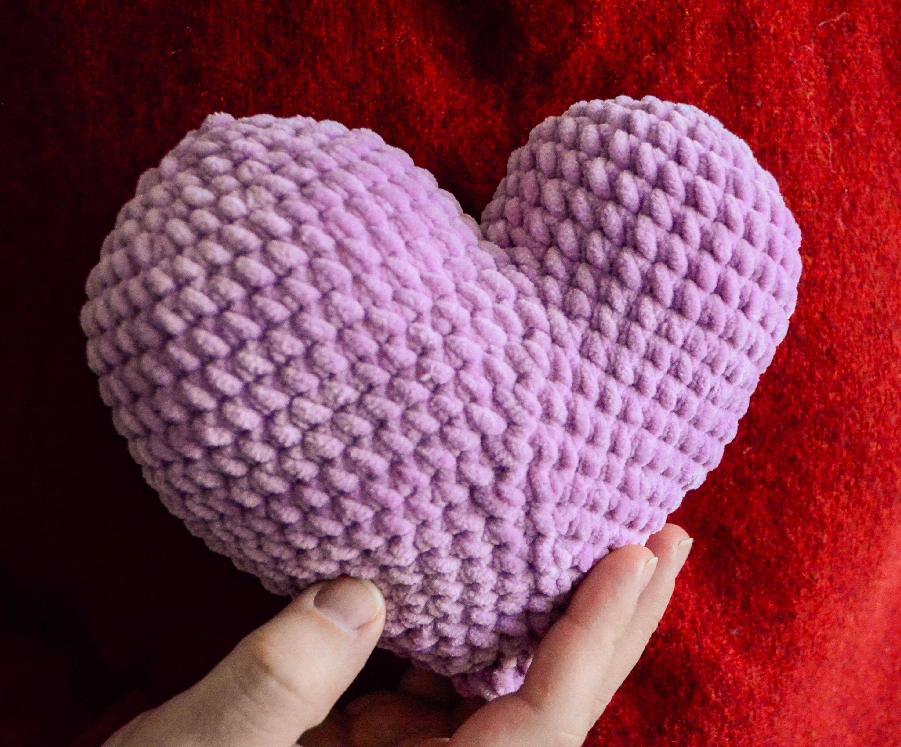 Free amigurumi heart pattern - Patchy heart sample held in a hand