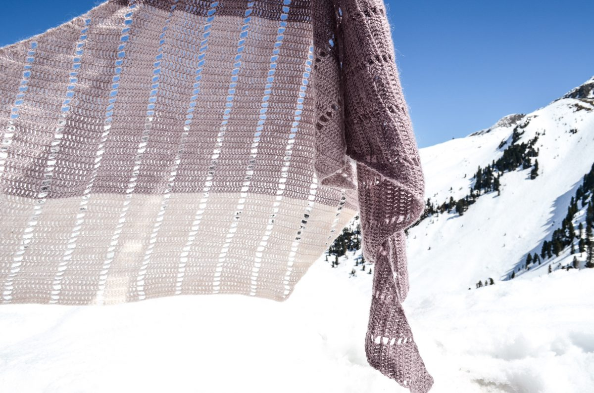 Draped shawl with white mountains in the background
