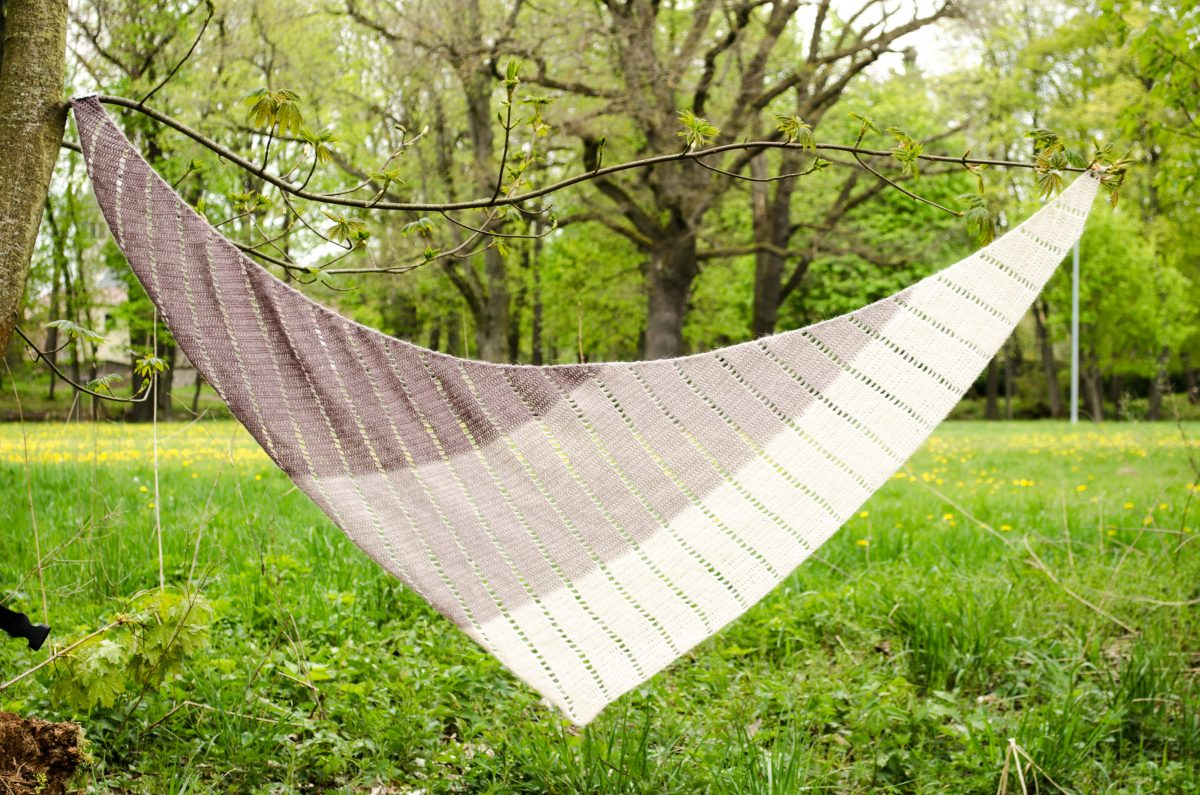 Extended shawl hanging on two branches